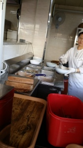 A chef preparing the vegan-friendly toppings for the jeon.