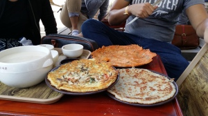 Kimchi Jeon in the back, potao jeon on the right, and bindaetteok (mung-bean pancake) on the left.