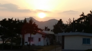 Sunrise over some houses.